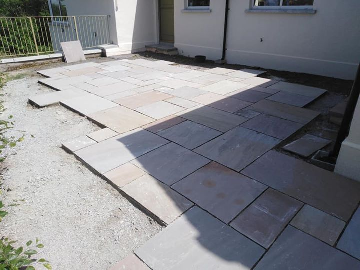 Sandstone paving job in Dromore started, but not finished until back from holida…